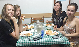 group of spanish students during dinner