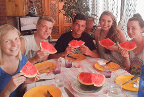 Students eating watermelon with Spanish School Berceo